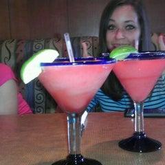 Photo taken at Boston's Restaurant & Sports Bar by Elsie V. on 3/7/2012