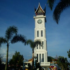 Photo taken at Jam Gadang by Tri A. on 12/4/2011