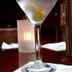 Photo taken at Fleming's Prime Steakhouse & Wine Bar by Manuel S. on 9/28/2011