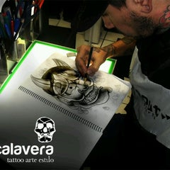 Photo taken at Calavera Tattoo Arte Estilo by Calavera T. on 5/14/2012