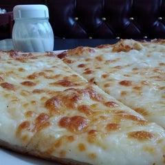 Photo taken at NY Pizza Company & Italian Bistro by Daniel X. on 6/27/2012