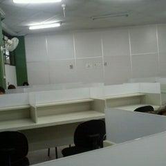 Photo taken at Biblioteca PUC Minas by Quel R. on 4/17/2012