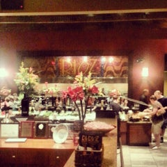 Photo taken at Rioz Brazilian Steakhouse by Terrence A. on 9/1/2012