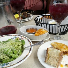 Photo taken at Tapeo Restaurant and Tapas Bar by Mike W. on 8/11/2012