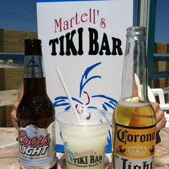 Photo taken at Martell's Tiki Bar by Eugene T. on 6/3/2011