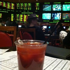 Photo taken at The Mirage Race & Sports Book by Jeremy L. on 1/1/2012
