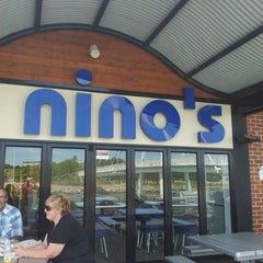 Photo taken at Nino's Fish Bar & Cafe by Novia W. on 1/23/2012