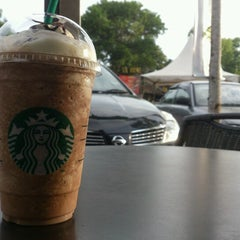 Photo taken at Starbucks by Sam on 6/8/2012