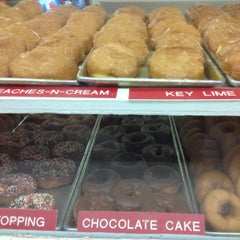 Photo taken at Thomas Donut & Snack Shop by Sarah T. on 9/3/2012