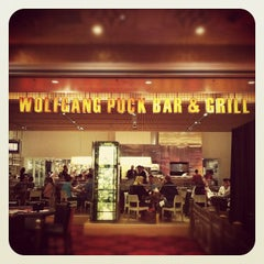 Photo taken at Wolfgang Puck Bar & Grill by Jimmy T. on 2/23/2012