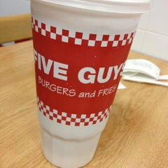 Photo taken at Five Guys by Justine O. on 3/12/2012
