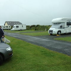 Photo taken at Tregurrian Camping and Caravanning Club Site by Mat M. on 7/2/2012