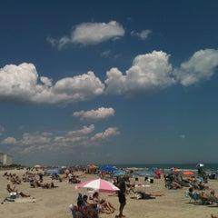 Photo taken at 44th street beach by Michael Z. on 6/23/2012