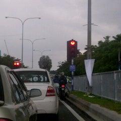 Photo taken at Traffic Light Gate UiTM Seksyen 7 by Mohammad Zaifah A. on 10/26/2011