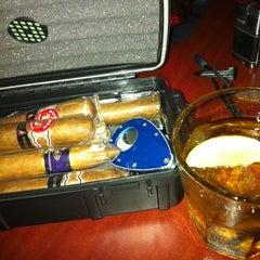 Photo taken at LIT Premium Cigar Lounge by Dennis P. on 6/22/2012