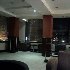 Photo taken at Cinnabon Bakery Cafe by Haris N. on 12/5/2011