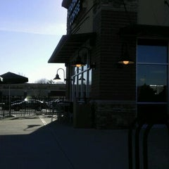 Photo taken at Starbucks by CHRISTIE R. on 1/6/2012