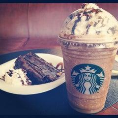 Photo taken at Starbucks by Olga on 8/23/2012