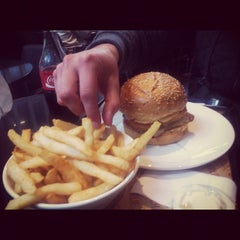Photo taken at Charlie & Co. Burgers by Fiona M. on 7/22/2012