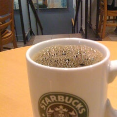 Photo taken at Starbucks Coffee 神田駅前店 by Ryuzy on 3/16/2012