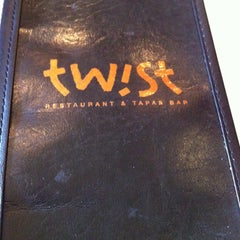 Photo taken at Twist Restaurant & Tapas Bar by Melissa Estrella I. on 6/20/2012