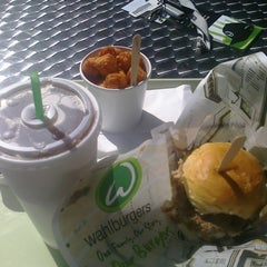 Photo taken at Wahlburgers by thuan v. on 3/18/2012