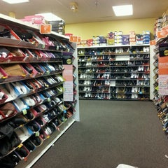 Photo taken at Payless ShoeSource by HorrorArtist M. on 1/3/2012