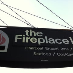 Photo taken at The Fireplace Inn by Adam V. on 8/19/2011
