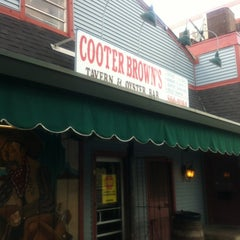 Photo taken at Cooter Brown's Tavern & Oyster Bar by Rita L. on 7/19/2012
