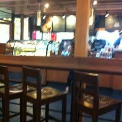 Photo taken at Starbucks (สตาร์บัคส์) by Teerayut S. on 3/19/2012