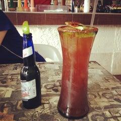 Photo taken at Barracrudas Beach Lounge by Ranas & Charles by Alejandra M. on 5/12/2012