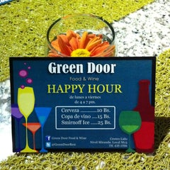 Photo taken at Green Door Food & Drinks by Green Door Caracas on 3/27/2012