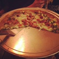 Photo taken at Bombay Pizza Co. by Leah F. on 4/5/2012