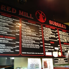 Photo taken at Red Mill Burgers by J S. on 12/9/2011
