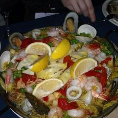 Photo taken at Tapeo Restaurant and Tapas Bar by Evan D. on 12/11/2011