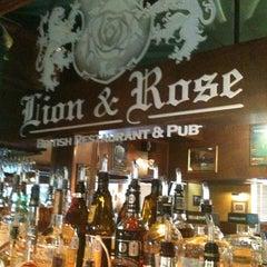 Photo taken at The Lion & Rose British Restaurant & Pub by Katie T. on 6/15/2011