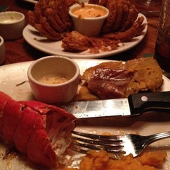 Photo taken at Outback Steakhouse by Andrew L. on 3/20/2012