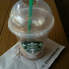 Photo taken at Starbucks by Evie D. on 8/8/2012