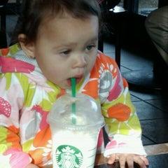 Photo taken at Starbucks by Penelope B. on 1/2/2012