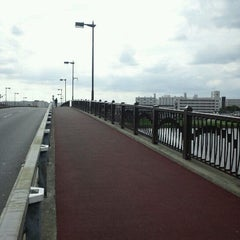 Photo taken at 飯塚橋 by Keitaro Y. on 9/25/2011