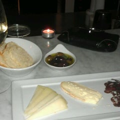 Photo taken at Cellar Wine Bar by Amanda H. on 1/12/2012