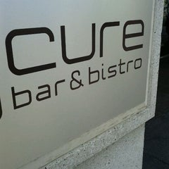 Photo taken at Cure Bar & Bistro by J. R. S. on 8/19/2011