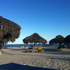 Photo taken at Los Corales Beach by Mariana B. on 1/8/2012