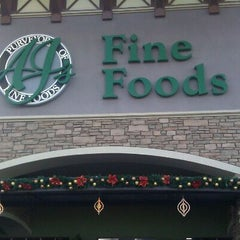 Photo taken at AJ's Fine Foods by C L. on 12/23/2011