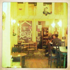 Photo taken at Kookoo Cafe by Rebecca on 3/18/2011