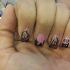 Photo taken at Nails First & Spa by Tara C. on 10/8/2011