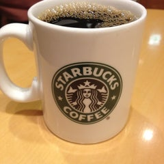 Photo taken at Starbucks Coffee 神田駅前店 by Nao M. on 4/20/2012