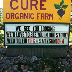 Photo taken at Cure Organic Farm by Kate Y. on 7/18/2012