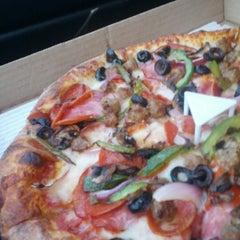 Photo taken at Garlic Jim's by Adrian P. on 7/7/2012