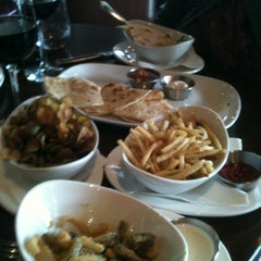 Photo taken at Roxy Restaurant and Bar by Monica D. on 5/4/2012